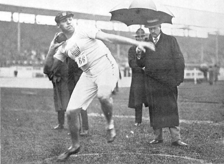 "Shot put competition, Summer Olympics 1908 in London.  Source: Illustration in the ""Fourth Olympiad 1908 London Official Report"" published by the British Olympic Association in 1909"